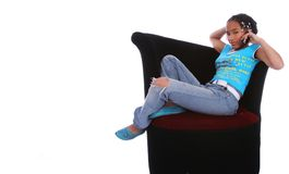 African American Girl Talking. Isolated african american girl relaxing on sofa with her foot up and talking on the phone Royalty Free Stock Image