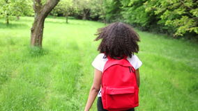 African American girl teenager female young woman hiking with red backpack stock video footage