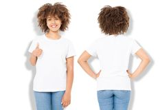 African american girl in white t shirt template and shadow on isolated wall background. Blank t shirt design. Front and back view. Mock up and copy space stock images