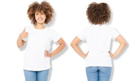 African american girl in white t shirt template and shadow on isolated wall background. Blank t shirt design. Front and back view. Mock up and copy space royalty free stock images