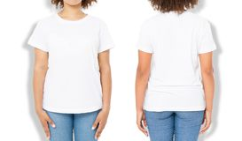 African american girl in white t shirt template and shadow on isolated wall background. Blank t shirt design. Front and back view. Mock up and copy space stock photo