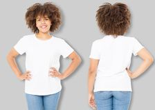 African american girl in white t shirt template and shadow on isolated wall background. Blank t shirt design. Front and back view. Mock up and copy space royalty free stock photo