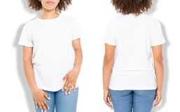 African american girl in white t shirt template and shadow on isolated wall background. Blank t shirt design. Front and back view. Mock up and copy space royalty free stock photos