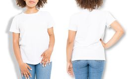 African american girl in white t shirt template and shadow on isolated wall background. Blank t shirt design. Front and back view. Mock up and copy space royalty free stock image