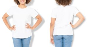 African american girl in white t shirt template and shadow on isolated wall background. Blank t shirt design. Front and back view. Mock up and copy space stock image