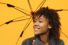 African American girl with yellow umbrella Royalty Free Stock Photo