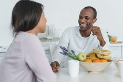 african american girlfriend and boyfriend sitting at table stock image