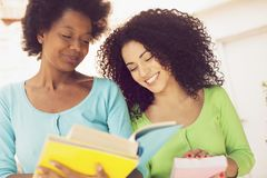 African american girls reading book, back to school. Happy african american girls reading book, back to school Royalty Free Stock Photo