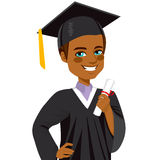 African American Graduation Boy. African american boy student smiling on graduation day holding diploma on hand Royalty Free Stock Image