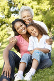 African American Grandmother, Mother And Daughter Relaxing In Park Royalty Free Stock Image