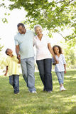 African American Grandparents With Grandchildren Walking In Park Royalty Free Stock Images