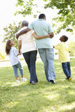 African American Grandparents With Grandchildren Walking In Park Stock Photo