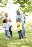African American Grandparents With Grandchildren Walking In Park Royalty Free Stock Image