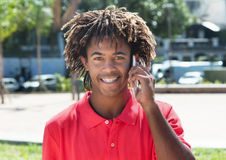 African american guy with amazing hairstyle at phone Royalty Free Stock Photo