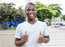 African american guy showing both thumbs outdoor Stock Photo