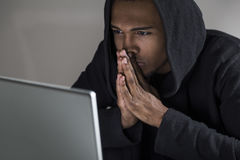 African American hacker plotting his attack Royalty Free Stock Photo