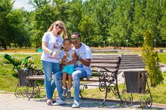African American happy family: black father, mom and baby boy on nature. Use it for a child, parenting or love concept stock image