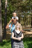 African American happy family: black father, mom and baby boy on nature. Royalty Free Stock Photos
