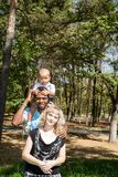 African American happy family: black father, mom and baby boy on nature Royalty Free Stock Photography