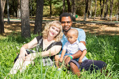African American happy family: black father, mom and baby boy on nature. Stock Images