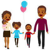 African American Happy Family Walking. Cute happy five member African American family walking together smiling Royalty Free Stock Photography