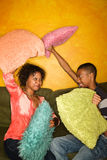African-American having pillow fight Stock Images