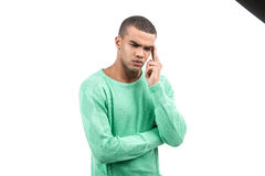 African american with head pain and green shirt. Thoughtful African Young Man Isolated Over White Background Stock Images