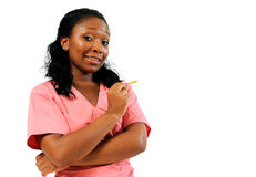African American Healthcare worker with needle. Young female African Amercican healthcare professional holding needle - uncertain facial expression royalty free stock photography