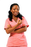 African American Healthcare worker with needle. Young female African Amercican healthcare professional holding needle - uncertain facial expression royalty free stock images