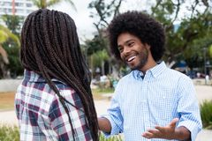 African american hipster man flirting with woman. African american hipster men flirting with women outdoors in the city Stock Images