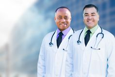 African American and Hispanic Male Doctors Outside of Hospital B Royalty Free Stock Images