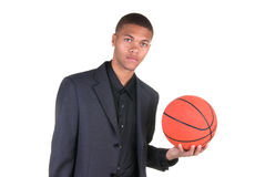 African American holding basketball Royalty Free Stock Image