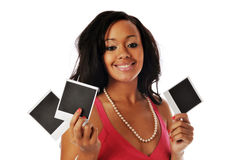 African american holding snapshots Royalty Free Stock Image