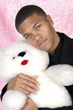 African American holding teddy bear Royalty Free Stock Photo