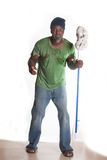 African American homeless man. Cleaning with mop Royalty Free Stock Photo