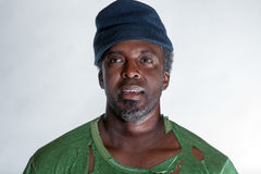 African American homeless man. With hat Royalty Free Stock Image