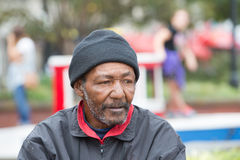 African american homeless man. Outdoors posing for portrait Stock Image