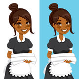 African American Housekeeping Woman. African American hotel service woman housekeeping worker holding white towels and bedclothes in two different background Royalty Free Stock Photography