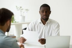 African-american hr manager looking doubtful skeptical about hir. African american hr manager looking doubtful about hiring incompetent candidate, uncertain stock photography