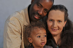 African American husband, Caucasian wife and multi. African American father with wife and mixed race son Stock Image
