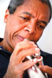 African american jazz musician. African american jazz musician with his flugelhorn Royalty Free Stock Photos