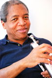 African american jazz musician. African american jazz musician with his flugelhorn Stock Photo