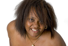 African american lady. A caribbean lady with wild hair against a white background Stock Photos