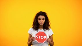 African-American lady showing stop sign, women rights protection, feminism. African-American lady showing stop sign, woman rights protection, feminism, stock royalty free stock images
