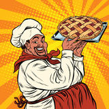 African American or Latino cook with a berry pie Royalty Free Stock Images