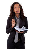 African american lawyer holding a book. Young african american lawyer holding a book  and looking up Stock Images