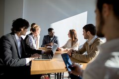 Business people listening to marketing professional african speaker presentation Royalty Free Stock Photo