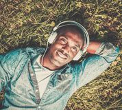 African american listens music in a park Royalty Free Stock Photography