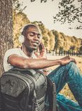 African american listens music in a park Stock Photos