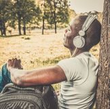 African american listens music in a park Royalty Free Stock Photo